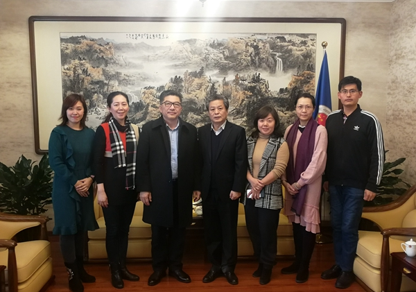 陈德海秘书长会见广西艺术学院副校长韦俊平一行