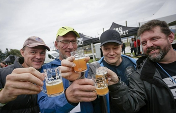 People taste craft beer at BC Hop Festival in Abbotsford, Canada